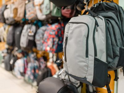 Showcase with backpacks in sports shop, nobody. Summer active leisure, showcase with bags, professional travelling equipment