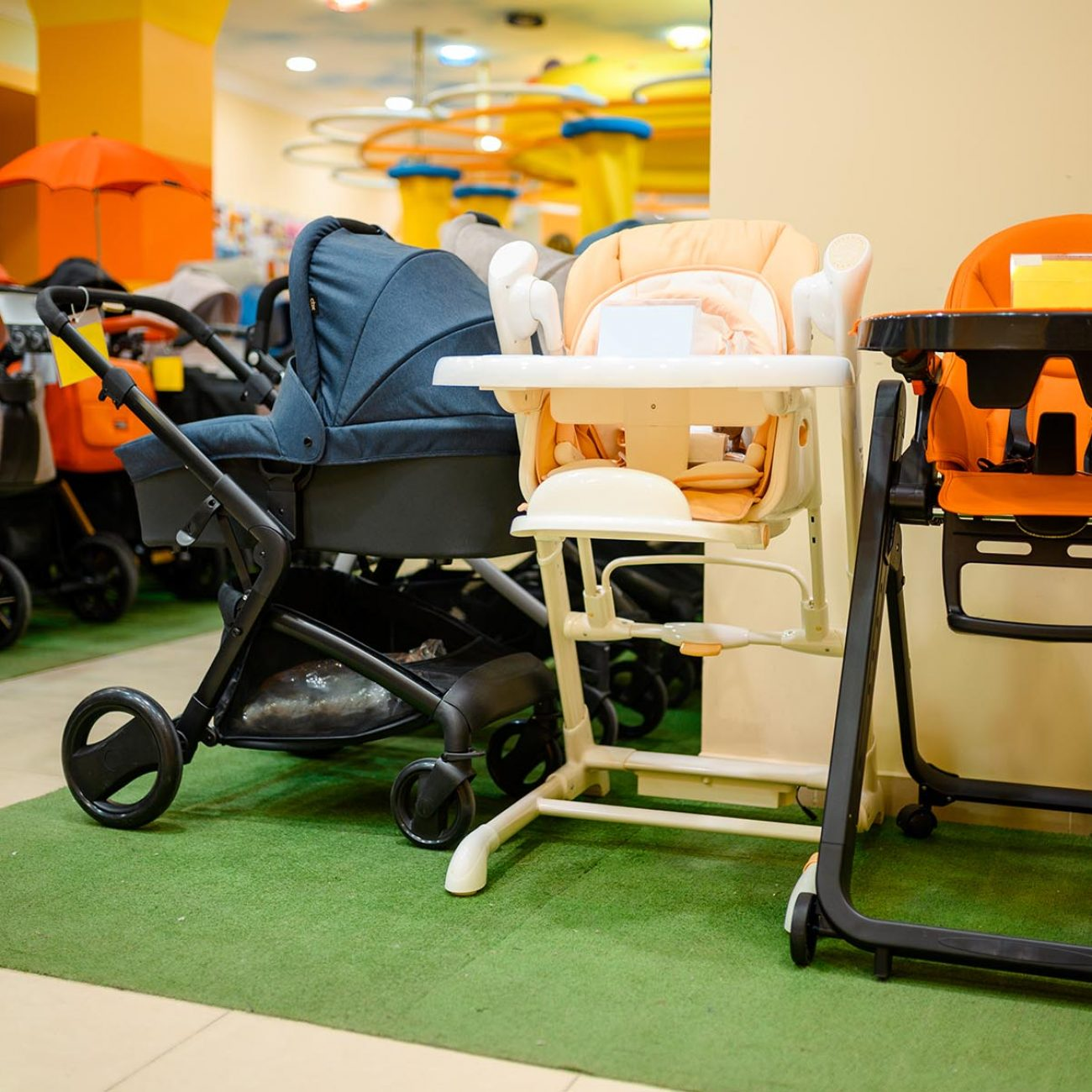 Baby strollers assortment in children's store. Showcase with perambulator variety in kid's shop, child transportation department, nobody